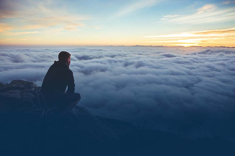 Man staring out at clouds